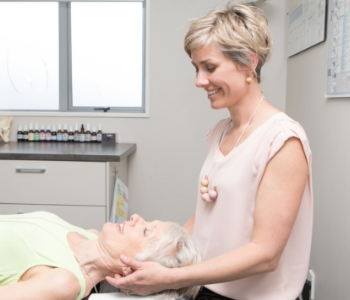 Dr Jolanta Williams giving gentle chiropractic adjustment to woman