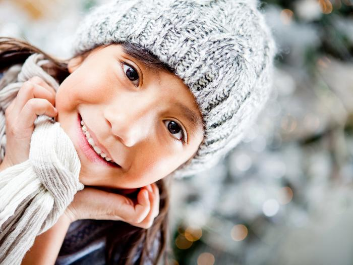 Small child in winter hat and scarf